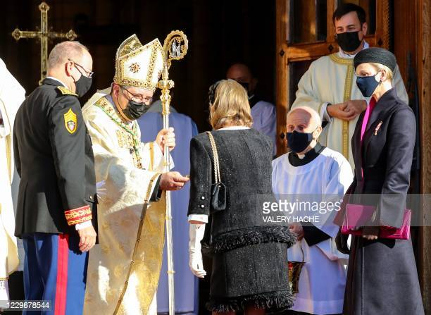 Princess Charlene of Monaco and Prince Albert II of Monaco , wearing face masks, arrive prior to a mass during the celebrations marking Monaco's...