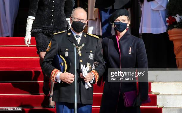 Princess Charlene of Monaco and Prince Albert II of Monaco, wearing face masks, leave after attending a mass during the celebrations marking Monaco's...