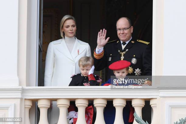 Princess Charlene of Monaco and Prince Albert II of Monaco with childre Jacques and Gabriella pose at the Palace balcony during the Monaco National...