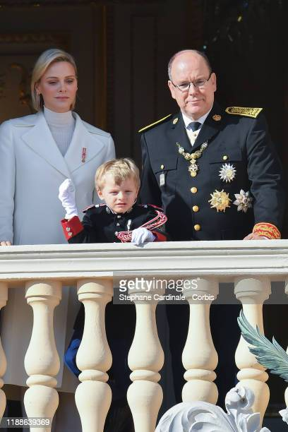 Princess Charlene of Monaco and Prince Albert II of Monaco with Prince Jacques of Monaco pose at the Palace balcony during the Monaco National Day...