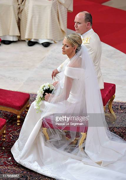 Princess Charlene of Monaco and Prince Albert Of Monaco arrive for the religious ceremony of the Royal Wedding of Prince Albert II of Monaco to...