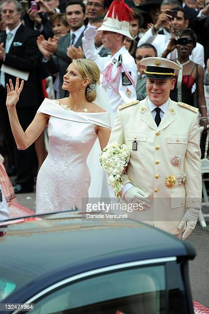 Princess Charlene of Monaco and Prince Albert Of Monaco smile as they leave the palace after the religious ceremony of the Royal Wedding of Prince...