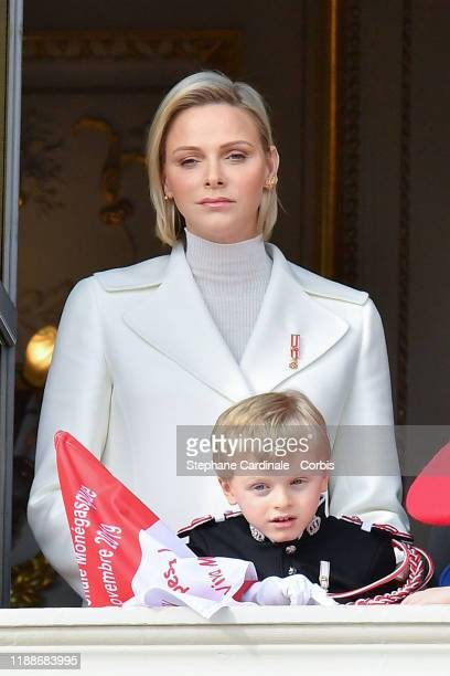 Princess Charlene of Monaco and Prince Jacques of Monaco pose at the Palace balcony during the Monaco National Day Celebrations on November 19, 2019...