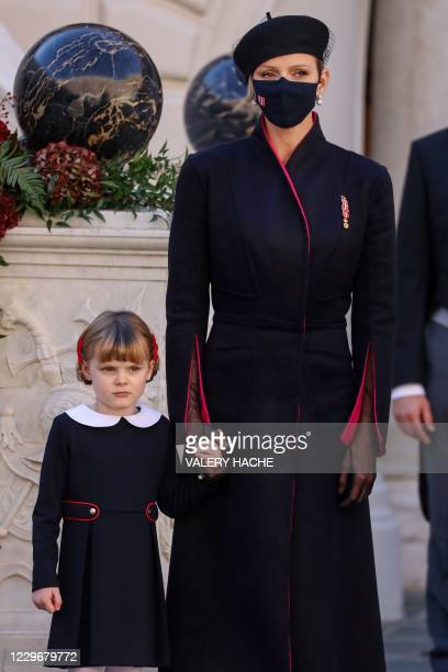 Princess Charlene of Monaco and Princess Gabriella of Monaco attend the celebrations marking Monaco's National Day at the Palace in Monaco, on...