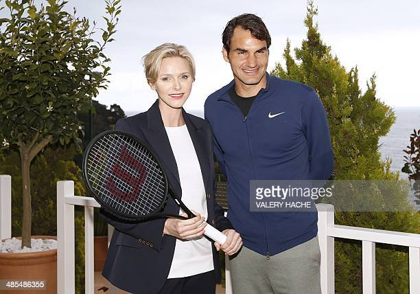 Princess Charlene of Monaco and Swiss tennis player Roger Federer pose for a photograph after a MonteCarlo ATP Masters Series Tournament tennis match...