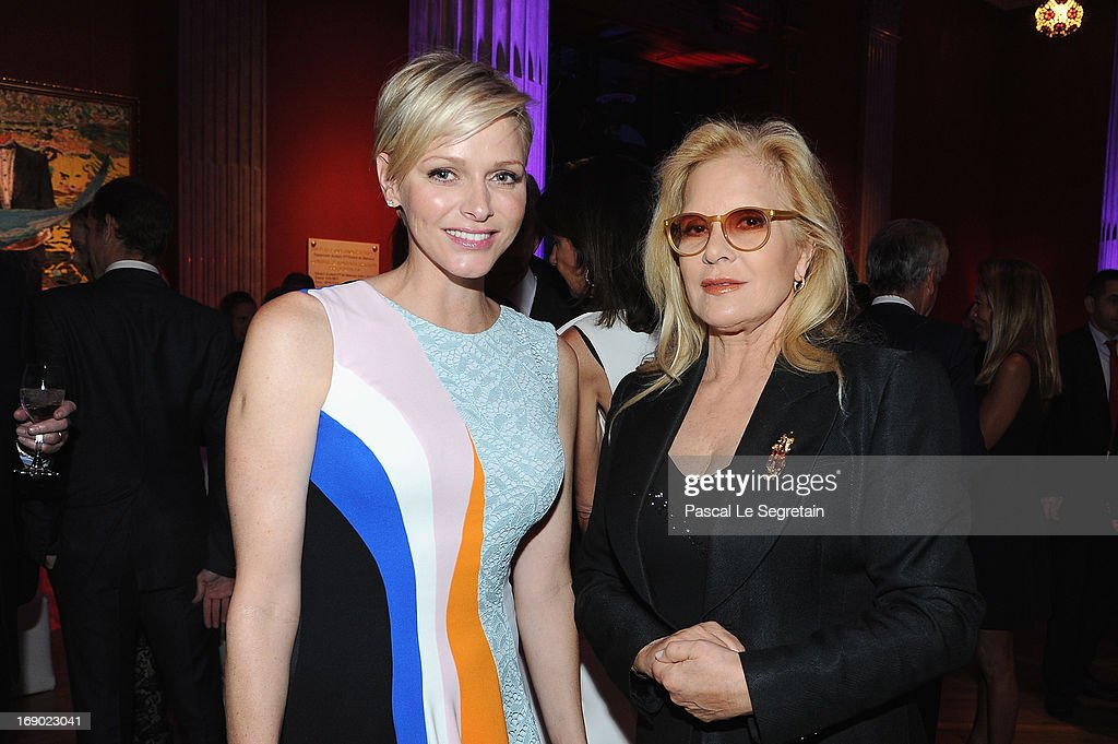 Princess Charlene of Monaco and Sylvie Vartan attend the Dior Cruise Collection 2014 cocktail on May 18, 2013 in Monaco, Monaco.