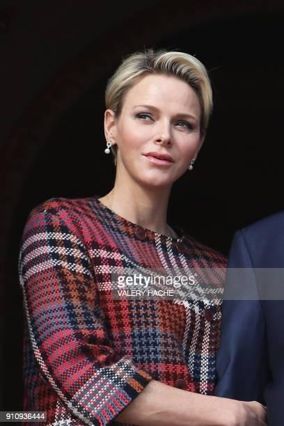 Princess Charlene of Monaco appears alongside her husband on the palace's balcony during Sainte Devote Celebrations in Monaco on January 27 2018...