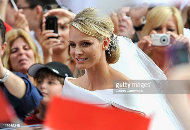 Princess Charlene of Monaco arrives at Sainte Devote church after the religious wedding ceremony to Prince Albert II of Monaco at the Prince's Palace...