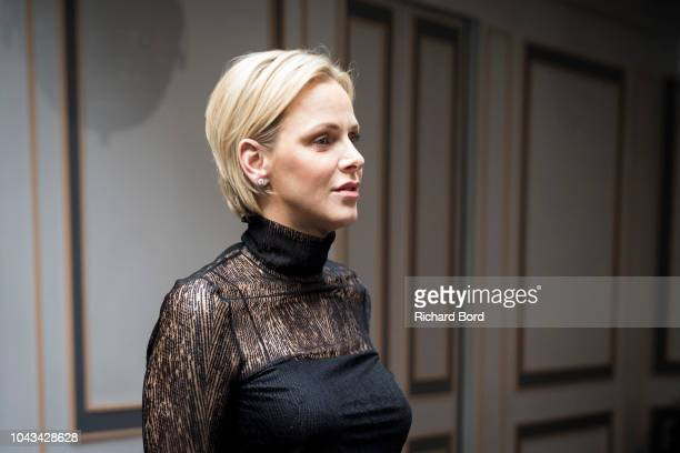 Princess Charlene of Monaco arrives backstage before the Akris show as part of the Paris Fashion Week Womenswear Spring/Summer 2019 on September 30...