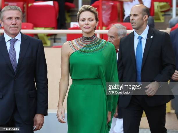 Princess Charlene of Monaco arrives with former Ukrainian pole vaulter Sergey Bubka to award medals at the IAAF Diamond League athletics meeting in...