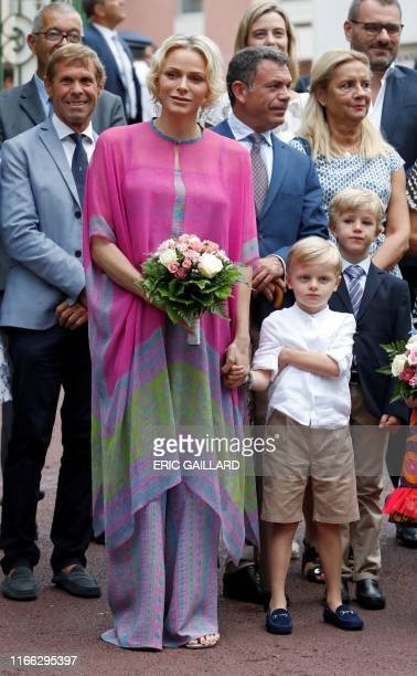 Princess Charlene of Monaco arrives with Prince Jacques to take part in the traditional Monaco picnic in Monaco September 6 2019