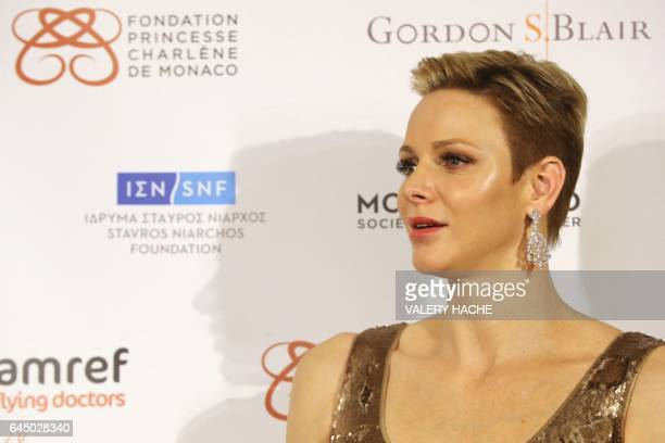 Princess Charlene of Monaco attends the AMREF gala on February 24 in Monaco / AFP / VALERY HACHE