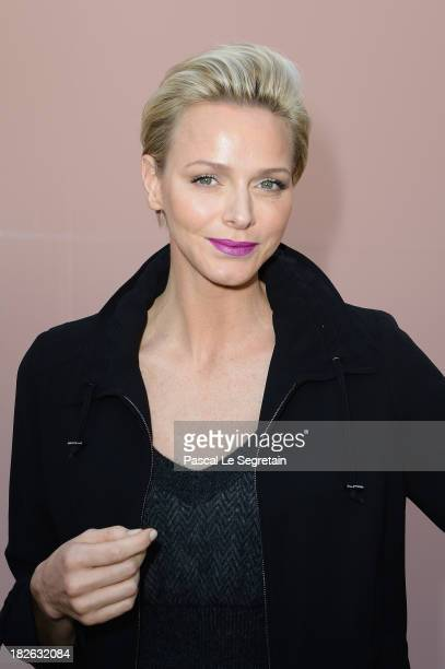 Princess Charlene of Monaco attends the Louis Vuitton show as part of the Paris Fashion Week Womenswear Spring/Summer 2014 at Le Carre du Louvre on...