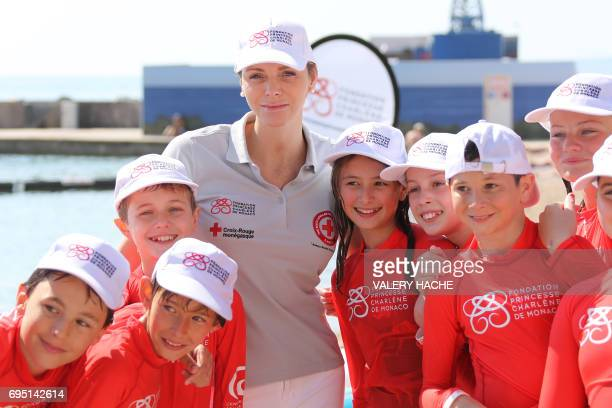 Princess Charlene of Monaco attends the 'Water Safety' day for the drowning prevention on Larvoto beach in Monaco on June 12 2017 / AFP PHOTO / POOL...