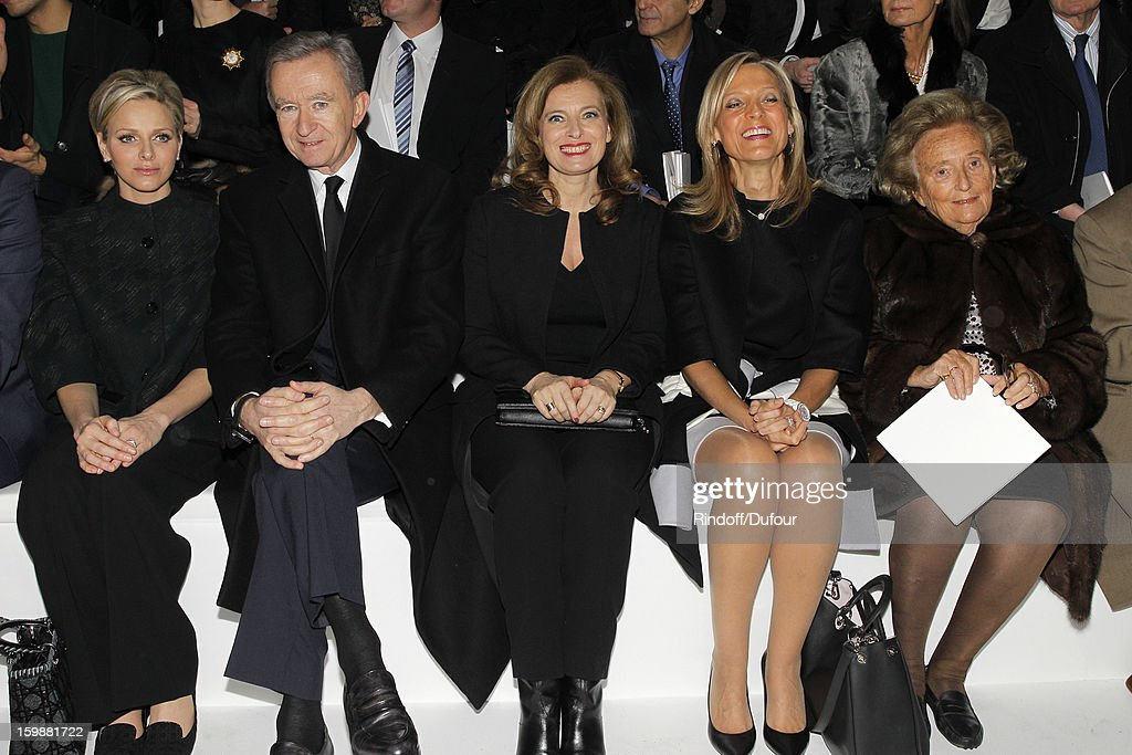Princess Charlene of Monaco, Bernard Arnault, Chairman and CEO of LVMH Moet Hennessy - Louis Vuitton, Valerie Trierweiler, Helene Arnault and Bernadette Chirac attend the Christian Dior Spring/Summer 2013 Haute-Couture show as part of Paris Fashion Week on January 21, 2013 in Paris, France.