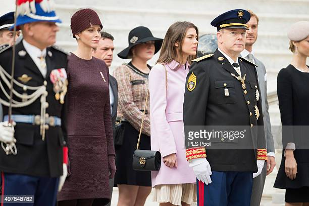 Princess Charlene of Monaco Charlotte Casiraghi and Prince Albert II of Monaco attend the Monaco National Day Celebrations on November 19 2015 in...