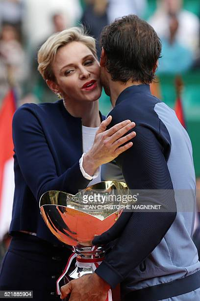 Princess Charlene of Monaco congratulates winner Spain's Rafael Nadal during the awarding ceremony following the final tennis match at the MonteCarlo...