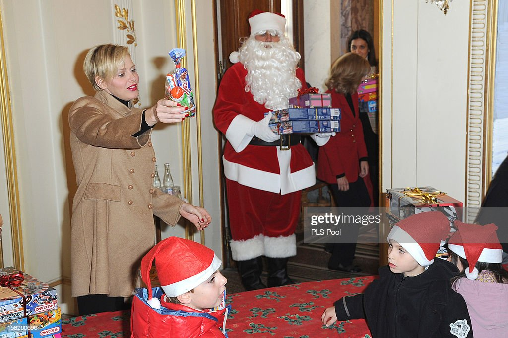 Princess Charlene of Monaco distributes presents to Monegasque children during the Christmas Celebration For Monaco Children on December 12, 2012 in Monaco, Monaco.
