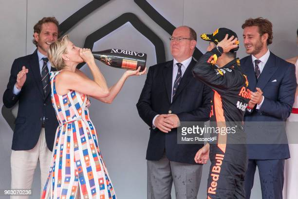Princess Charlene of Monaco drinks the winner champagne on the podium during the Monaco Formula One Grand Prix at Circuit de Monaco on May 27 2018 in...
