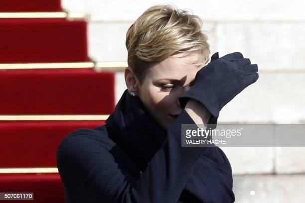 Princess Charlene of Monaco gestures as she leaves the Monaco Cathedral after the Sainte Devote festivities in Monaco on January 27 2016 Sainte...