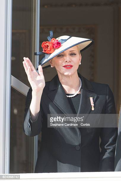 Princess Charlene of Monaco greets the crowd from the palace's balcony during the Monaco National Day Celebrations on November 19, 2016 in Monaco,...
