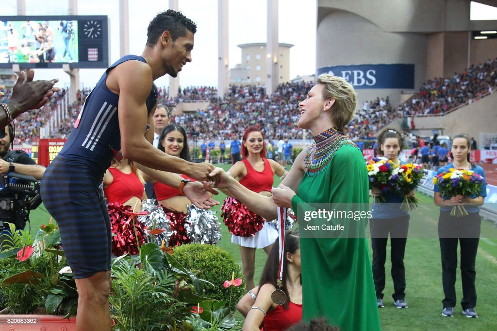 Princess Charlene of Monaco happily gives a medal to countryman Wayde van Niekerk of South Africa after his victory in the 400m during the IAAF Diamond League Meeting Herculis 2017 on July 21, 2017 in Monaco, Monaco.