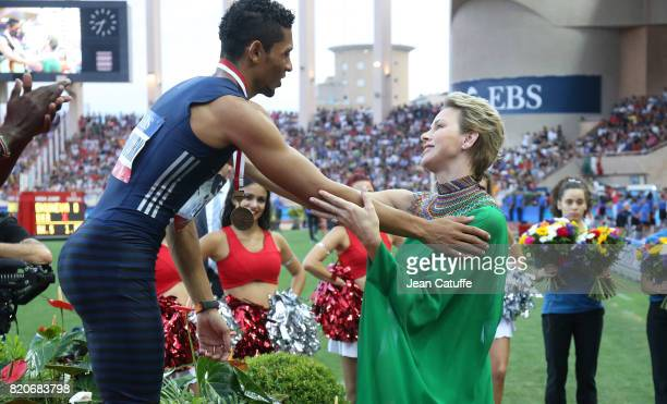 Princess Charlene of Monaco happily gives a medal to countryman Wayde van Niekerk of South Africa after his victory in the 400m during the IAAF...
