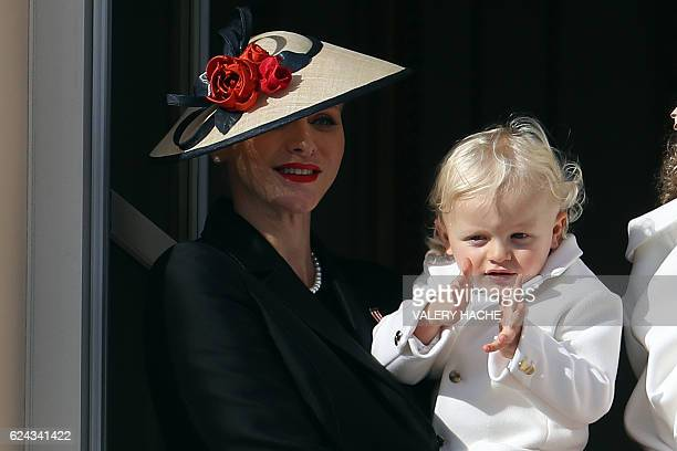 Princess Charlene of Monaco holding Prince Jacques appears on the balcony of the Monaco Palace during the celebrations marking Monaco's National Day,...