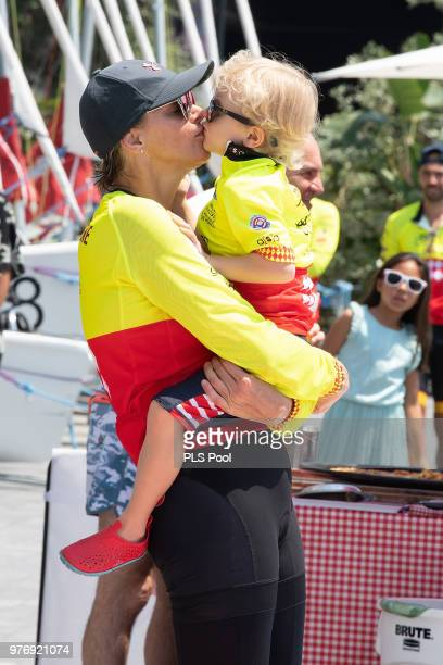 Princess Charlene of Monaco kisses her son Prince Jacques of Monaco during the Riviera Water Bike Challenge 2018 on June 17 2018 in Monaco Monaco