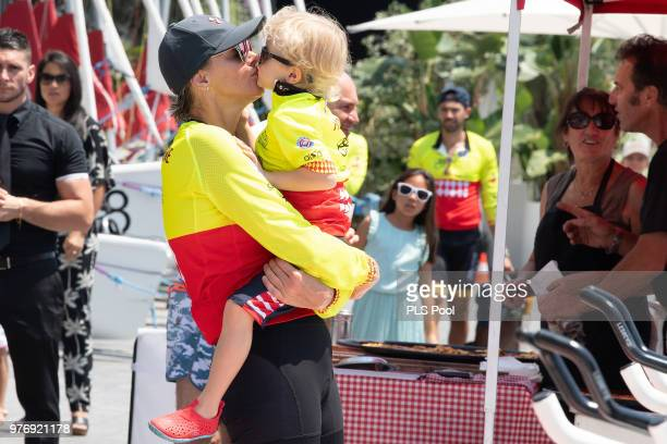 Princess Charlene of Monaco kisses her son Prince Jacques of Monaco during the Riviera Water Bike Challenge 2018 on June 17, 2018 in Monaco, Monaco.
