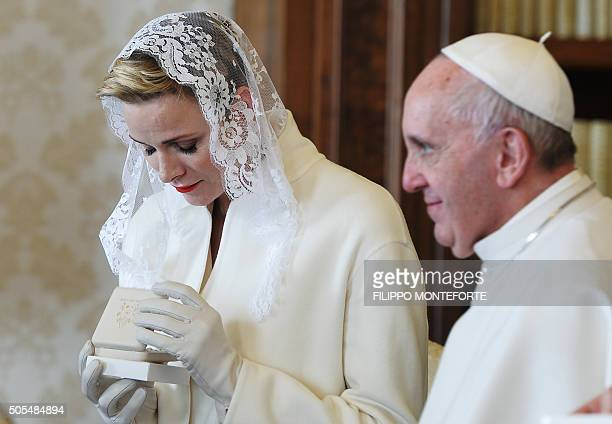 Princess Charlene of Monaco looks on during a private audience with Pope Francis at the Vatican on January 18 2016 / AFP / FILIPPO MONTEFORTE
