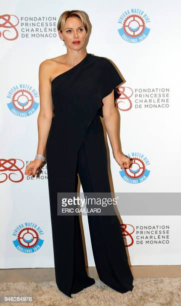 Princess Charlene of Monaco poses as she arrives for the Princess Charlene of Monaco Foundation fundraising Gala Dinner prior to the second edition...