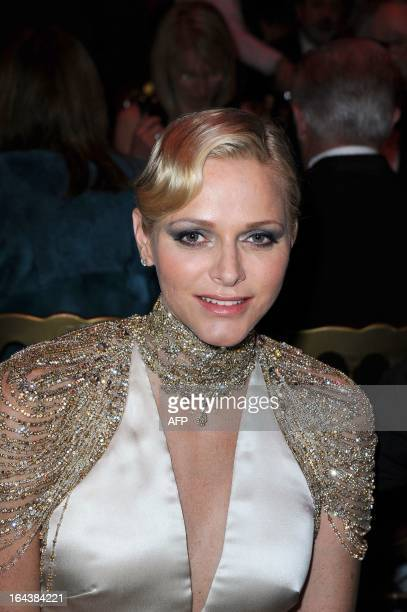 Princess Charlene of Monaco poses as she attends the Bal de la Rose du Rocher at the MonteCarlo Sporting Club in Monaco on March 23 2013 The Rose...
