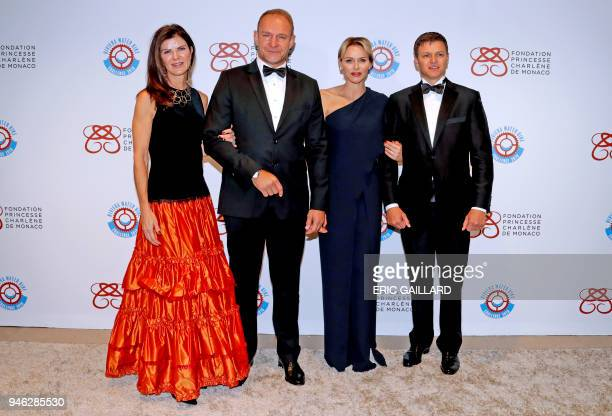 Princess Charlene of Monaco poses with former South African rugby player Francois Pienaar his wife Nerine and her brother Gareth Wittstock as they...