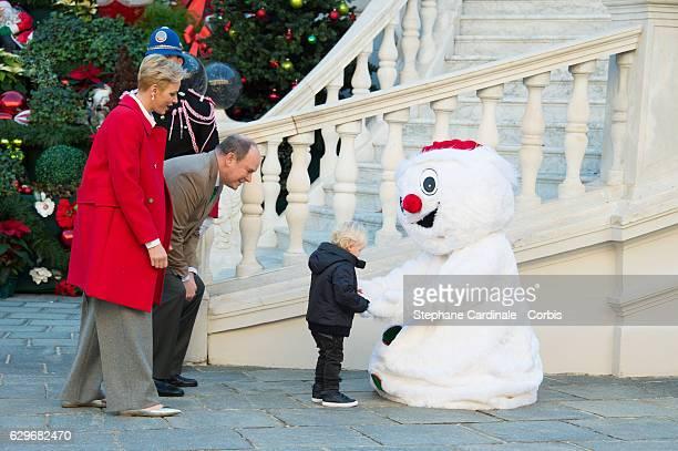 Princess Charlene of Monaco Prince Albert II of Monaco and Prince Jacques of Monaco attend the Christmas Gifts Distribution At Monaco Palace on...