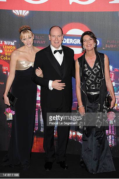 Princess Charlene of Monaco Prince Albert II of Monaco and Princess Caroline of Hanover attend the 'Swinging London' Monaco Rose Ball 2012 at...
