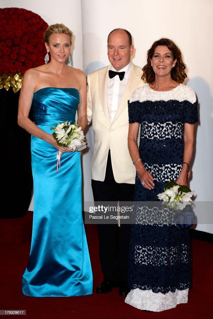 Princess Charlene of Monaco, Prince Albert II of Monaco and Princess Caroline of Hanover attend the 65th Monaco Red Cross Ball Gala at Sporting Monte-Carlo on August 2, 2013 in Monte-Carlo, Monaco.