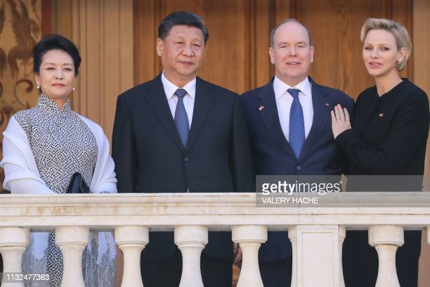 Princess Charlene of Monaco Prince Albert II of Monaco Chinese President Xi Jinping and his wife Peng Liyuan pose after their meeting at the Monaco...