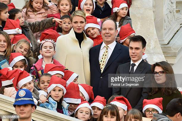 Princess Charlene Of Monaco Prince Albert II of Monaco Louis Ducruet and Camille Gottlieb pose with children during The Christmas Gifts Distribution...