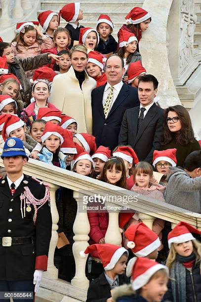 Princess Charlene of Monaco, Prince Albert II of Monaco, Louis Ducruet and Camille Gottlieb attend the Christmas gifts distribution on December 16,...