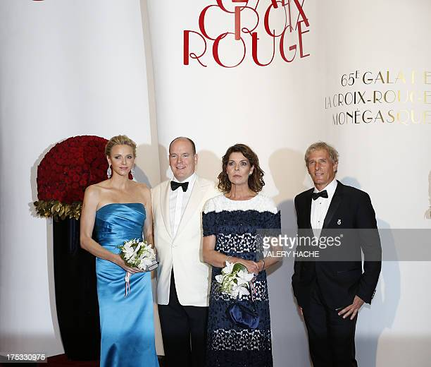 Princess Charlene of Monaco Prince Albert II of Monaco Princess Caroline of Hanover and Michael Bolton arrive to attend the 65th annual Red Cross...