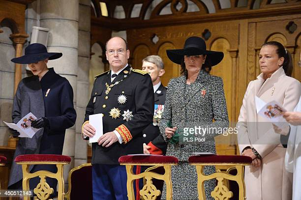 Princess Charlene of Monaco Prince Albert II of Monaco Princess Caroline of Hanover and Princess Stephanie of Monaco attend a mass at the Cathedral...