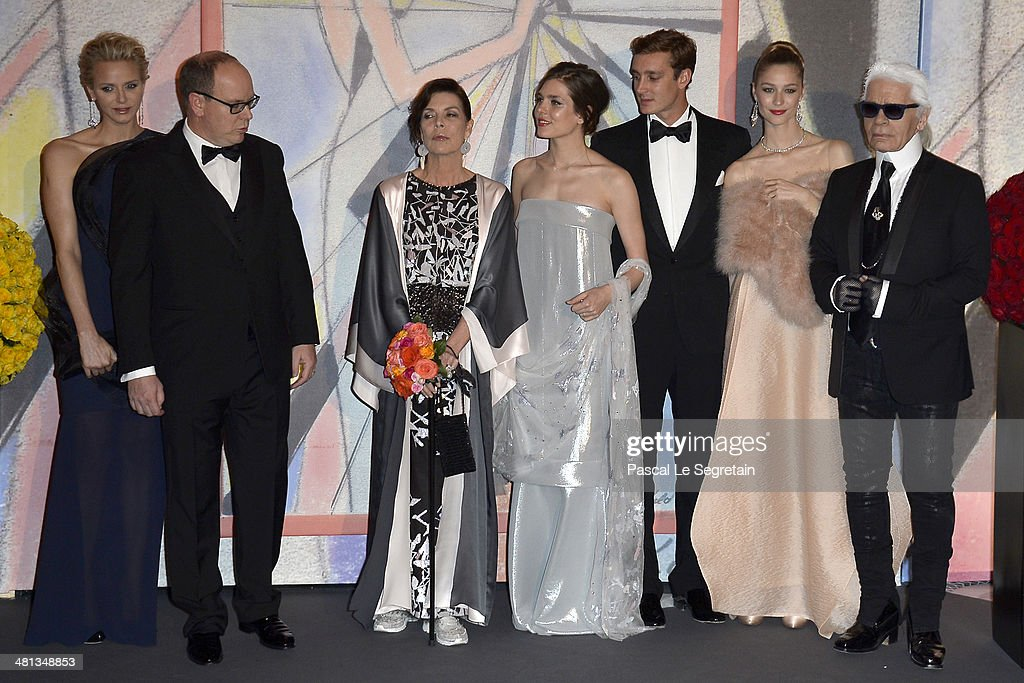 Princess Charlene of Monaco, Prince Albert II of Monaco, Princess Caroline of Hanover, Charlotte Casiraghi, Pierre Casiraghi, Beatrice Borromeo and Karl Lagerfeld attend the Rose Ball 2014 in aid of the Princess Grace Foundation at Sporting Monte-Carlo on March 29, 2014 in Monte-Carlo, Monaco.