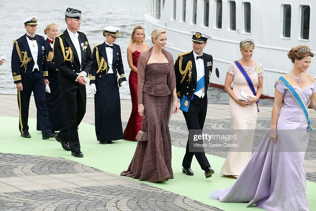 Princess Charlene of Monaco, Prince Edward, Earl of Wessex and Sophie, Countess of Wessex depart for the banquet after the wedding ceremony of Princess Madeleine of Sweden and Christopher O'Neill hosted by King Carl Gustaf XIV and Queen Silvia at The Royal Palace on June 8, 2013 in Stockholm, Sweden.