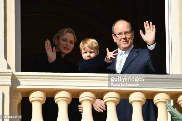 Princess Charlene of Monaco, Prince Jacques of Monaco and Prince Albert II of Monaco greet the crowd from the Palace balcony during the Celebration...