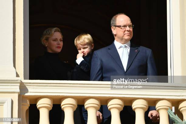 Princess Charlene of Monaco Prince Jacques of Monaco and Prince Albert II of Monaco greet the crowd from the Palace balcony during the Celebration Of...
