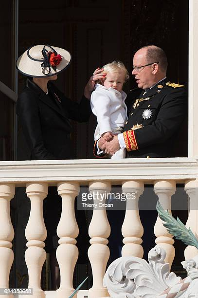 Princess Charlene of Monaco Prince Jacques of Monaco and Prince Albert II of Monaco greet the crowd from the palace's balcony during the Monaco...