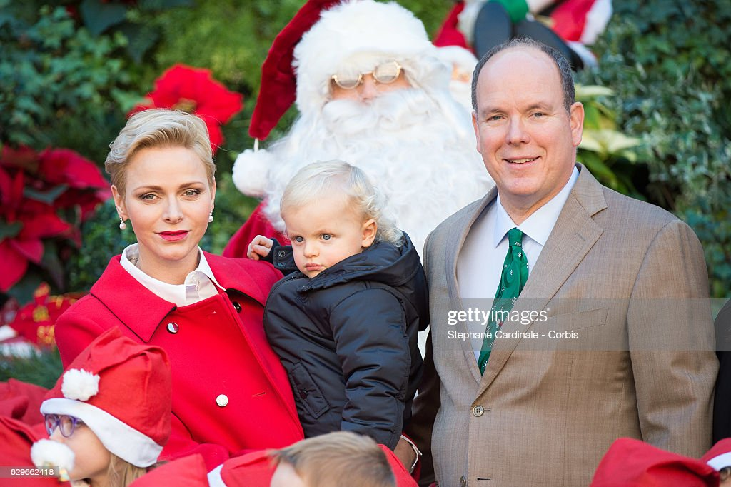 Princess Charlene of Monaco, Prince Jacques of Monaco and Prince Albert II of Monaco attend the Christmas gifts distribution at Monaco Palace on December 14, 2016 in Monaco, Monaco.