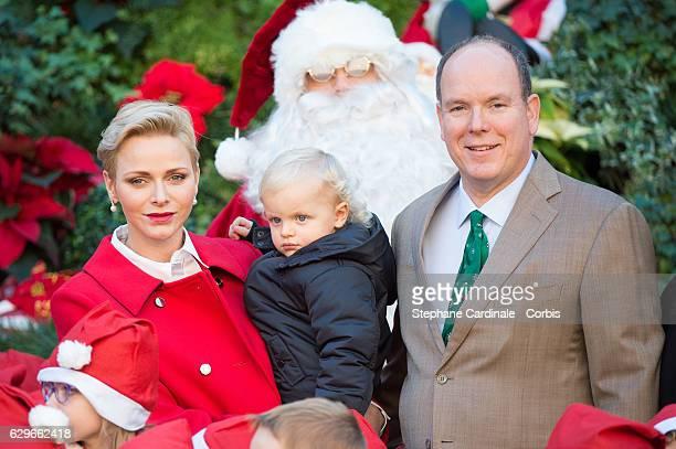 Princess Charlene of Monaco Prince Jacques of Monaco and Prince Albert II of Monaco attend the Christmas gifts distribution at Monaco Palace on...