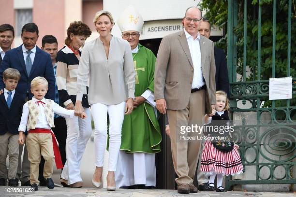 Princess Charlene of Monaco Prince Jacques of Monaco Prince Albert II of Monaco and Princess Gabriella of Monaco arrive to attend the Monaco annual...